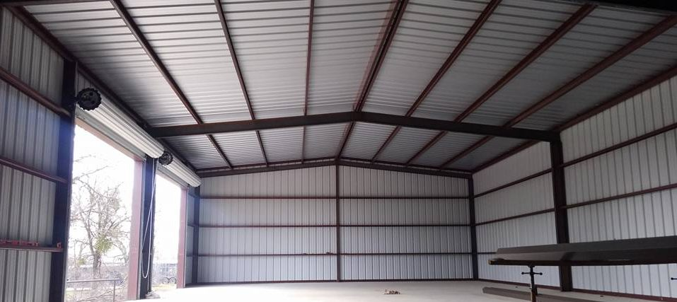 Huge metal shop with roll-up doors - Built near Austin, TX by D&M Metalworks