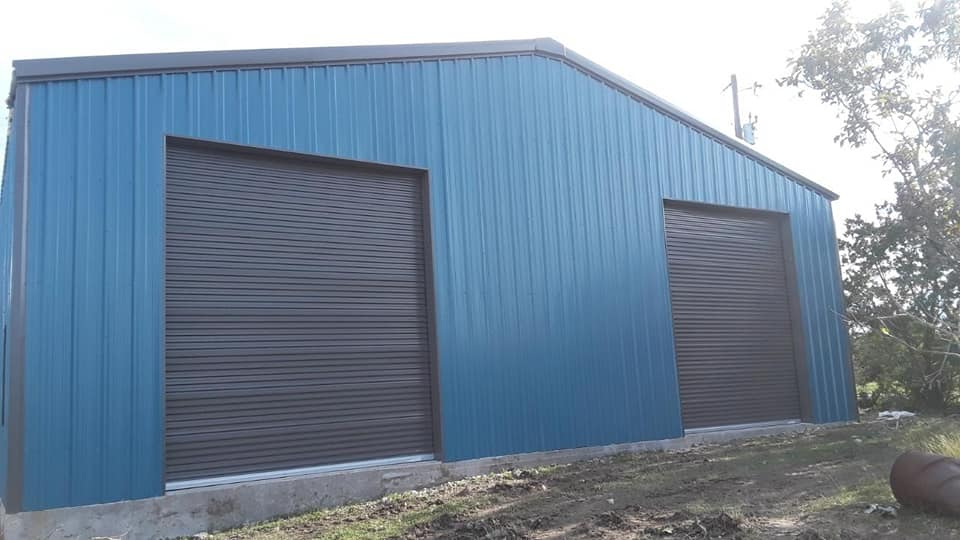Custom Blue Metal Building with two pull down doors